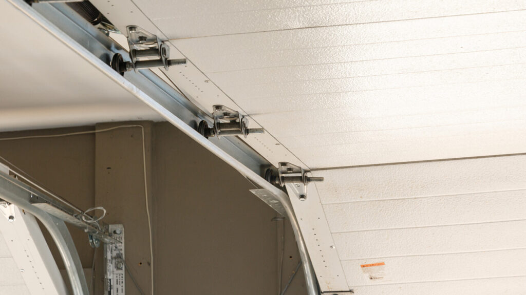 Cleaning And Inspecting A Garage Door Photo Eye